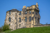 Edinburgh / Scotland / UK - 04/20/2014: View of a classic stone monument house on Calton Hill, blue sky as background