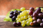 closeup of white, black and red table grapes