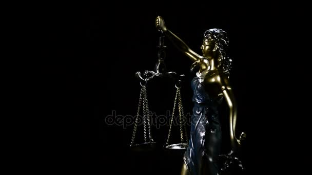 Lady justice in rotation over black background with strands of smoke