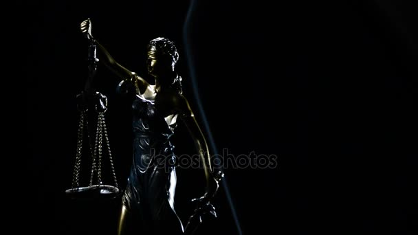 Figure of lady justice in rotation over black background with strands of smoke