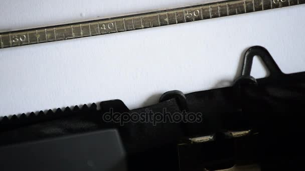 Typing the word RULES with an old manual typewriter