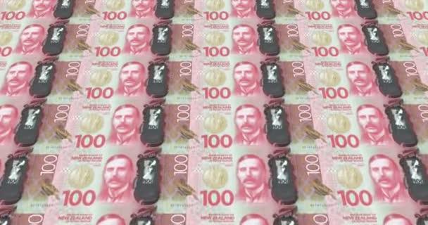 Le banconote da cento dollari della Nuova Zelanda di rotolamento, denaro contante, ciclo