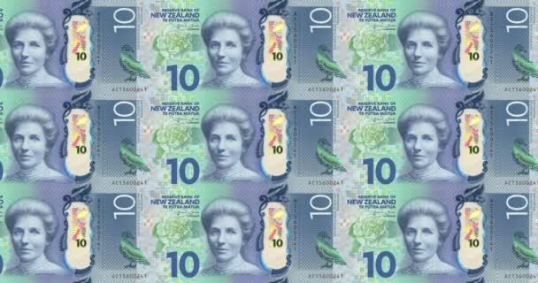 Le banconote da dieci dollari della Nuova Zelanda di rotolamento, denaro contante, ciclo