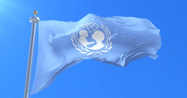 Flag of UNICEF, United Nations Childrens Fund,  waving at wind in slow, loop