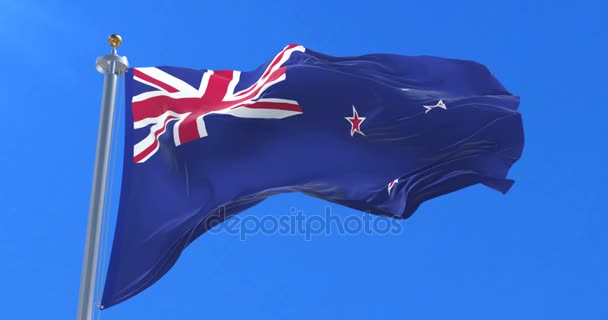 Nuova Zelanda bandiera ondeggiante al vento con cielo blu in ciclo lento,