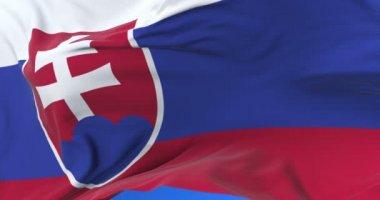 Slovakia flag waving at wind in slow in blue sky, loop