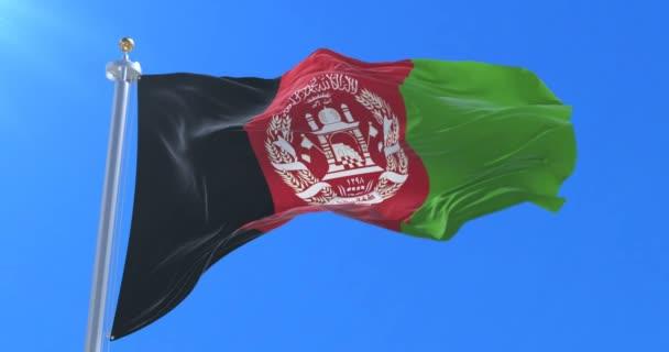 Afghanistan flag waving at wind in slow with blue sky, loop