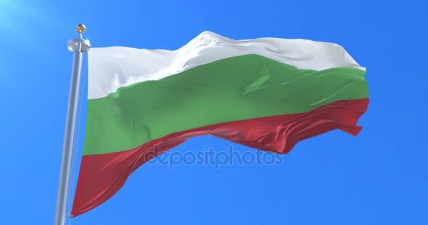 Bulgaria flag waving at wind in slow with blue sky, loop