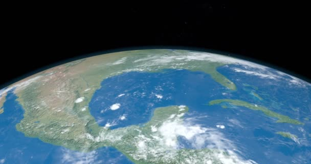 Animation of Mexico gulf in central america continent in planet earth from outer space gyrating in time lapse with the universe at background