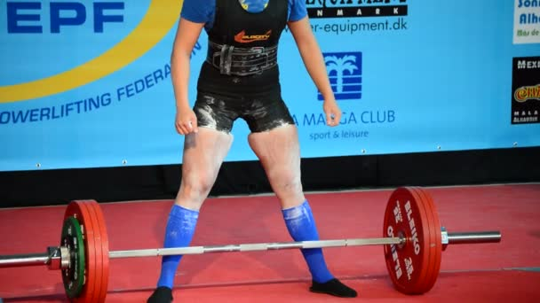 Weightlifter woman in a powerlifting championship, dead lift test