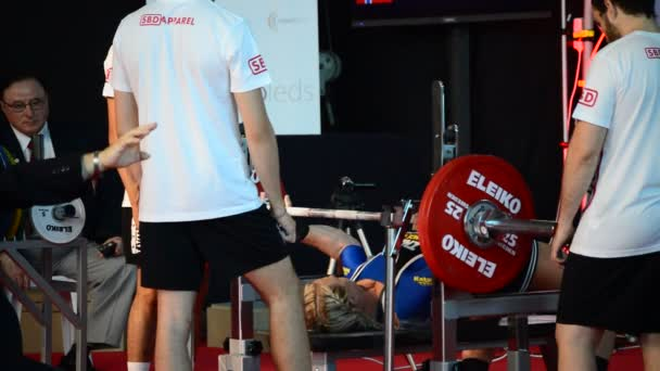 Weightlifter woman in a powerlifting championship in a bench press test