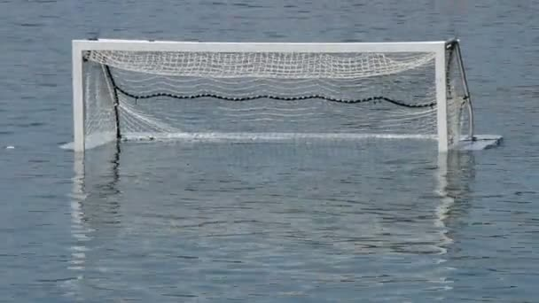 Empty goal of water polo in beach water