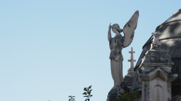 Angel statue on a grave in a cemetery
