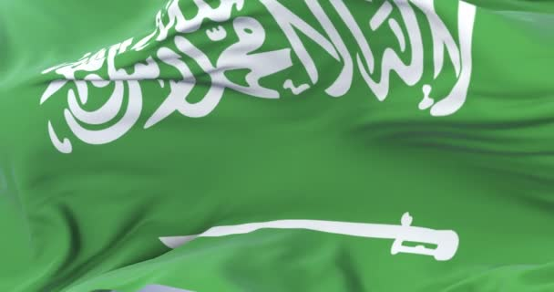Flag of Saudi Arabia waving at wind in slow with blue sky, loop