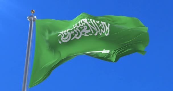 Saudi Arabia flag waving at wind in slow with blue sky, loop