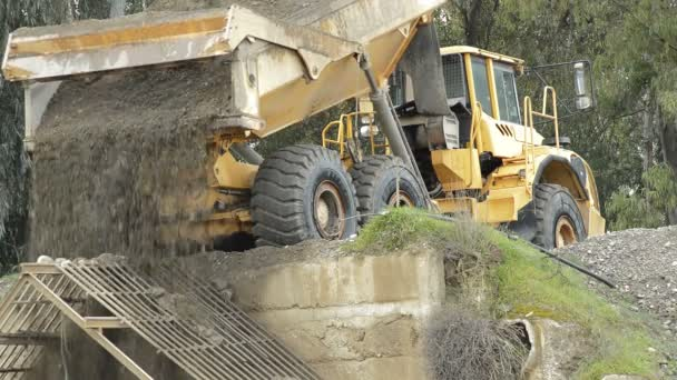 Construction truck unloading river sand just extracted in a sand quarry