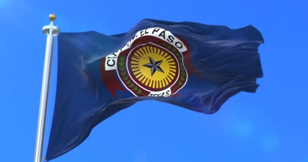 El Paso city flag, city of USA or United States of America, waving at wind in blue sky, slow - loop