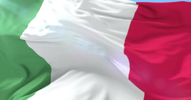 Flag of Italy waving at wind with blue sky, loop