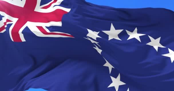 Bandiera delle Isole Cook ondeggiante al vento con cielo blu, ciclo