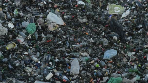 Mountain of glass and garbage in a landfill controlled waste at sunset