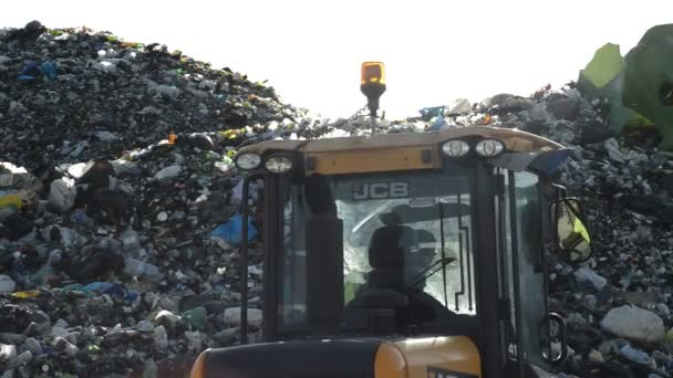 Mountain of glass and garbage in a landfill controlled waste