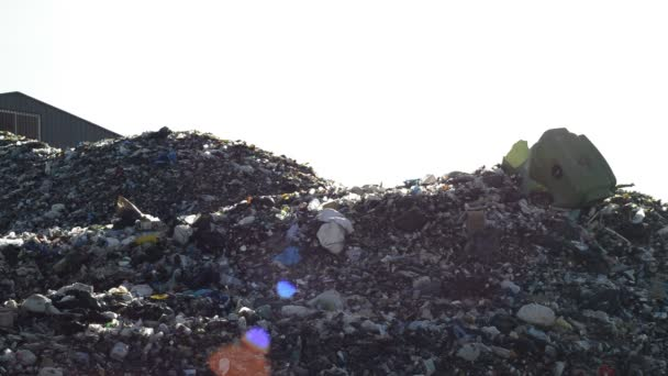 Mountains garbage and glass in a landfill controlled waste