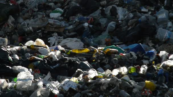 Garbage and glass in a landfill controlled waste