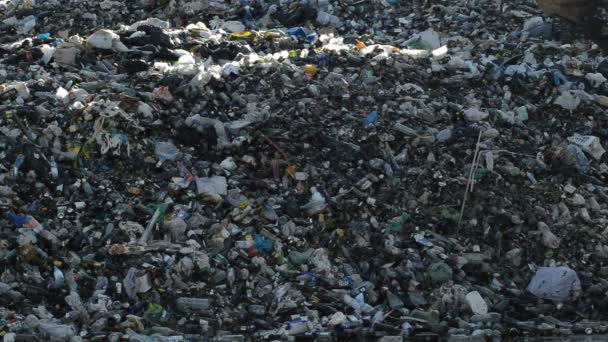 Mountain garbage and glass in a landfill controlled waste