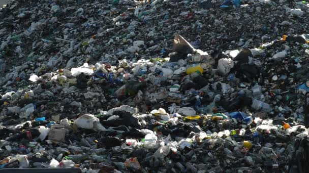 Mountain of garbage and glass in a landfill controlled waste at sunset