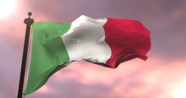Flag of Italy waving at wind at sunset, loop
