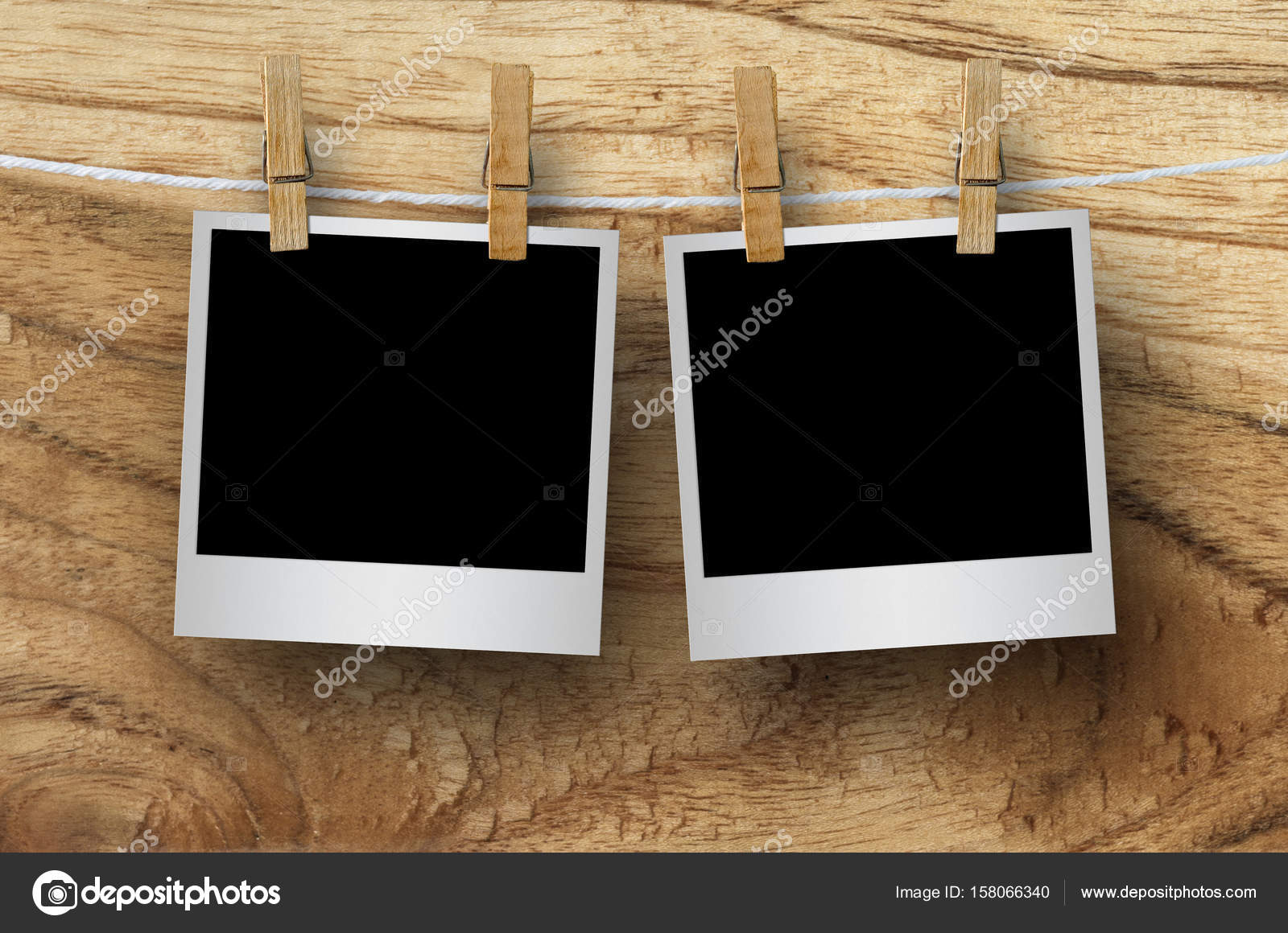 Blank photo frames with clothespins — Stock Photo © nirutdps #158066340