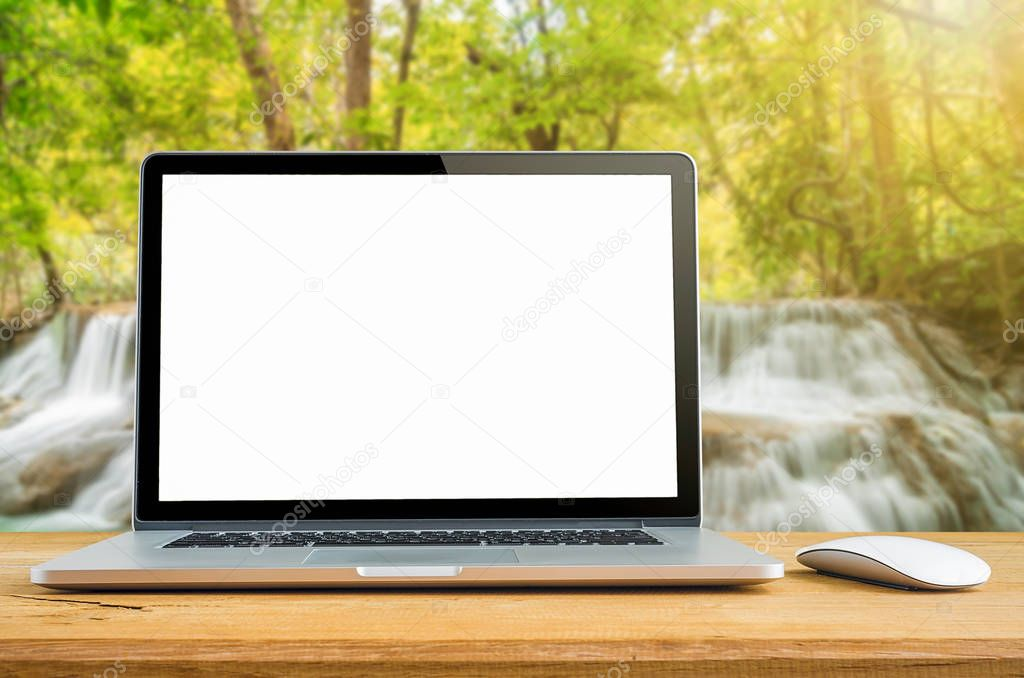 Laptop with blank screen on table