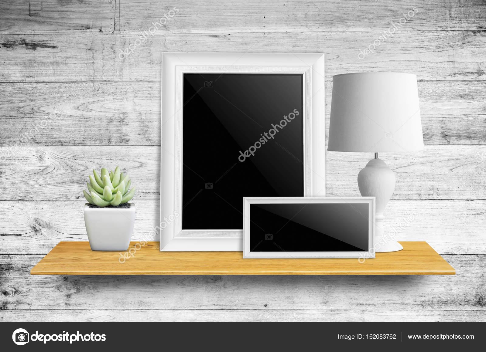 Empty Picture Frame On Bookshelf Stock Photo