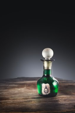 poison bottle on a wooden surface