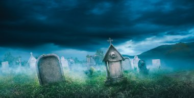 wide view of gravestones with fog