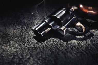 Smoking gun on the floor, high contrast image stock vector