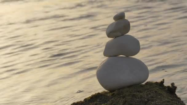 Stones balance on a background of sea On the Sunset.