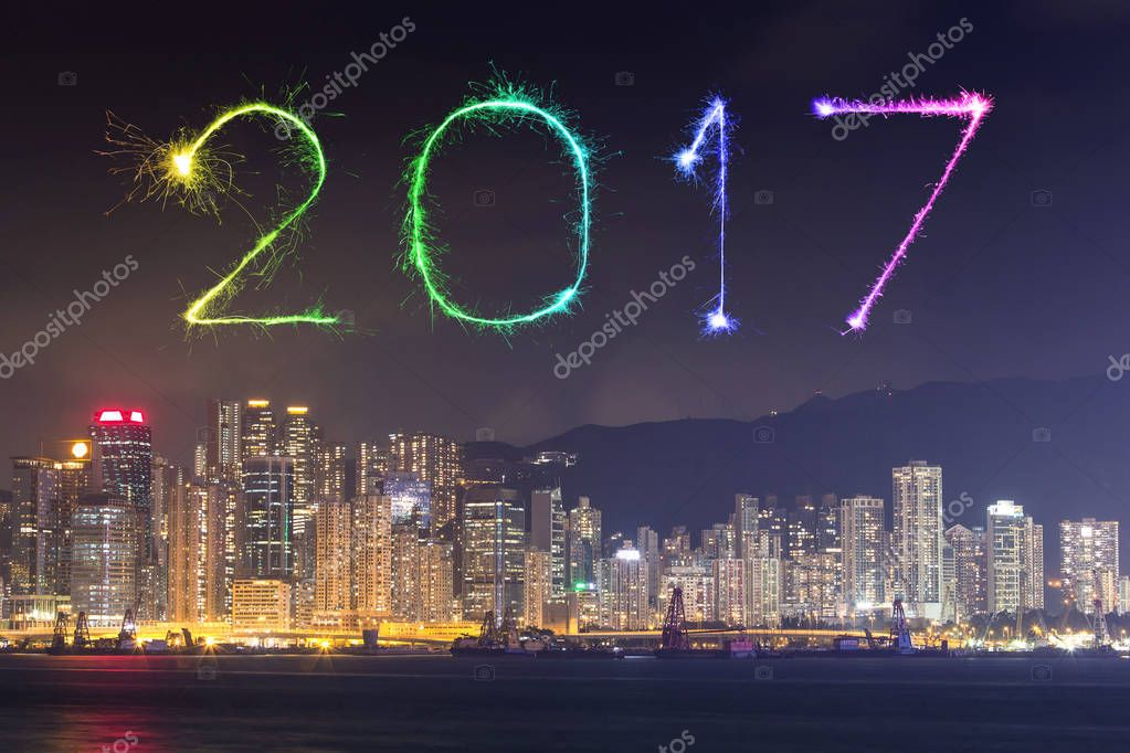 2017 happy new year fireworks celebrating over hong kong city at night view from victoria harbour photo by geargodz