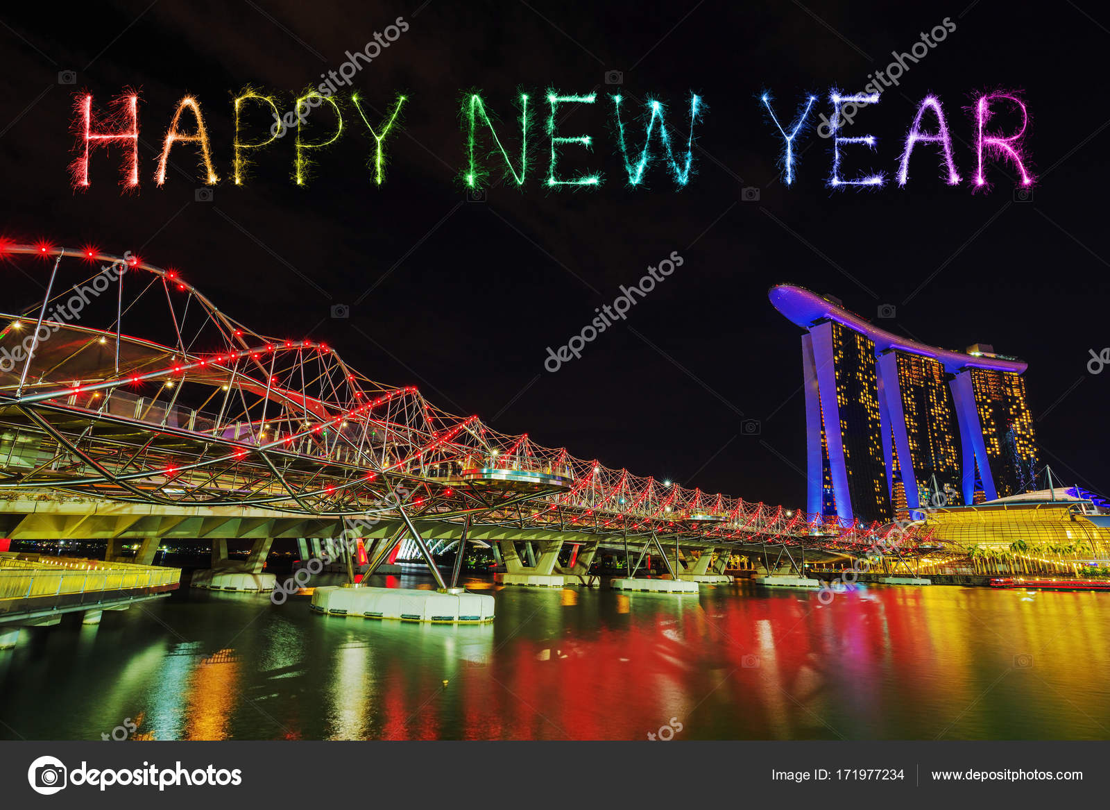 happy new year firework sparkle with the helix bridge singapore stock photo