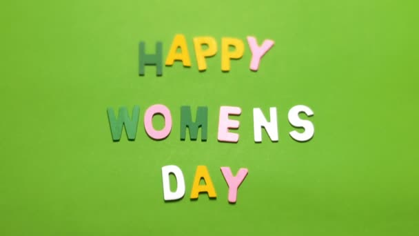 Happy Womens Day on green screen background.