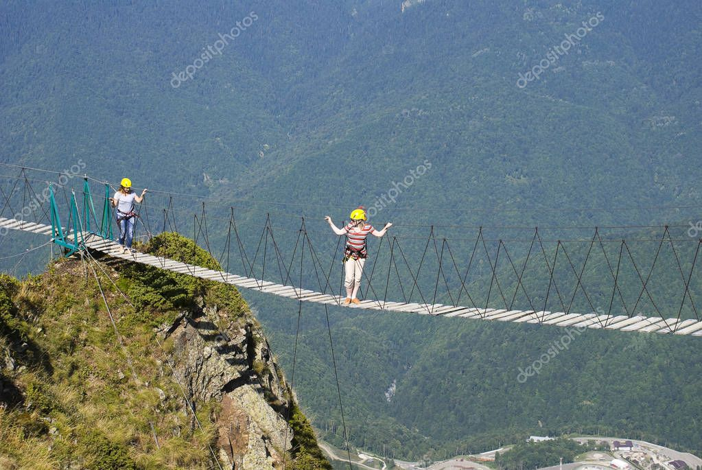 Tourists walk on a suspension bridge at 2,000 meters