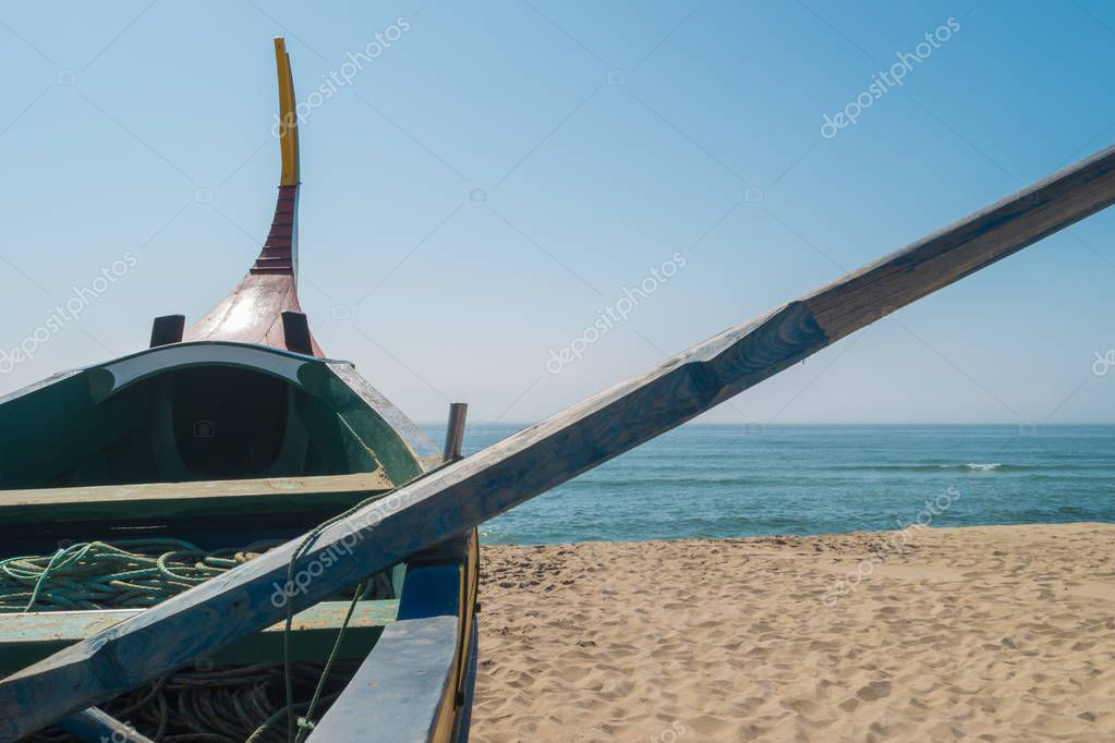 Arte Xavega typical portuguese old fishing boat on the beach