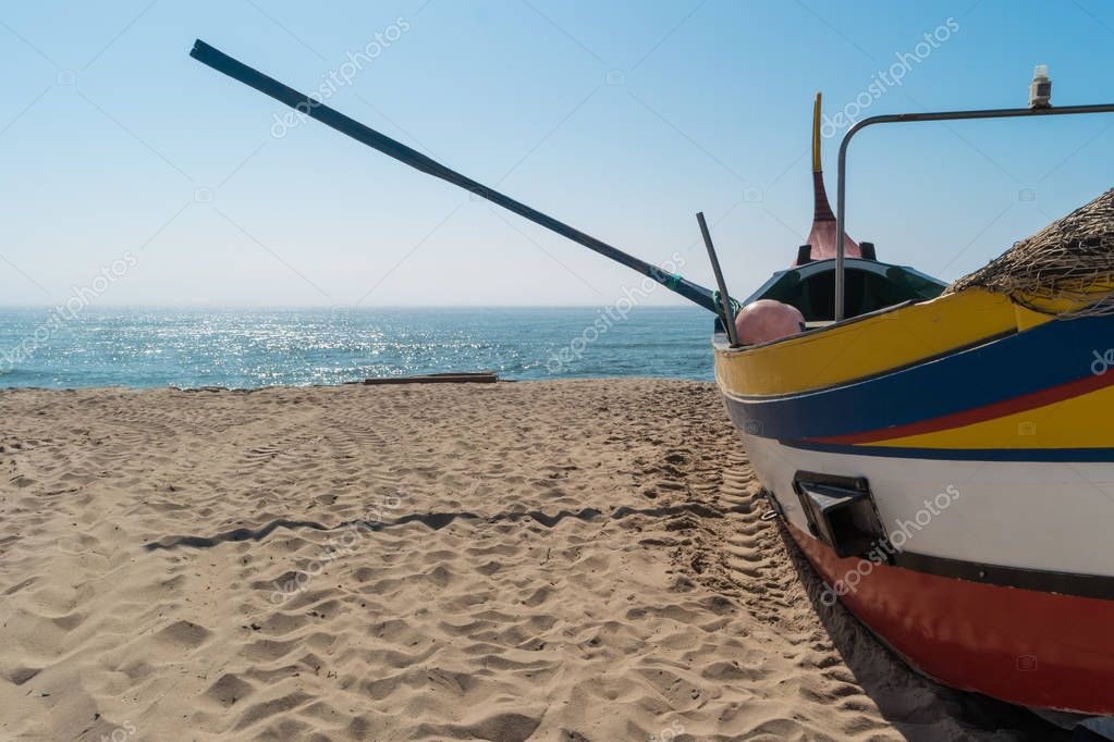 Arte Xavega typical portuguese old fishing boat on the beach in