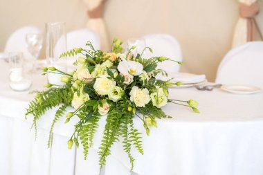 close-up of beautiful bouquet of white flowers on wedding table background