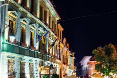 SIGHISOARA, ROMANIA - JULY 07, 2015: Night view of historic town Sighisoara. City in which was born Vlad Tepes, Dracula