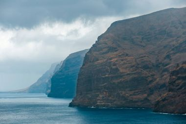 View of the cloudy cliffs of Los Gigantes in Tenerife, Canary Islands, Spain