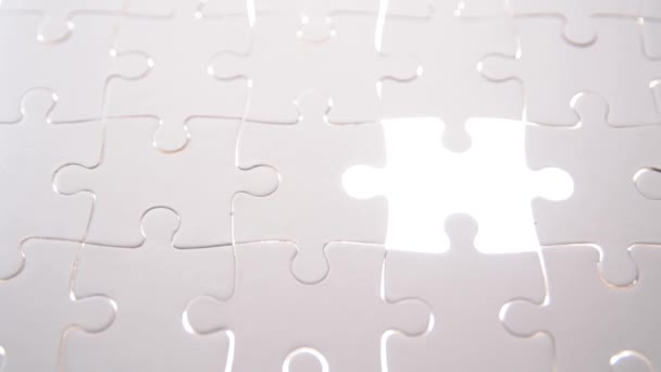 jigsaw puzzle piece with light glow, business concept for completing the final puzzle piece.
