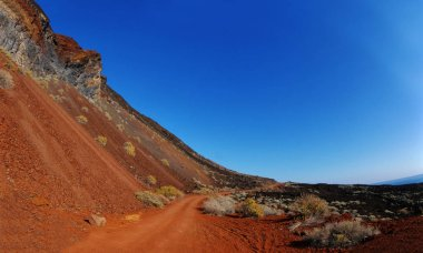 The red sand and rocks at Tacoron creek, El Hierro, Canary island, Spain