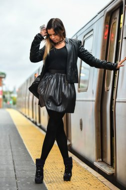 Sexy glamour woman posing at the train staion