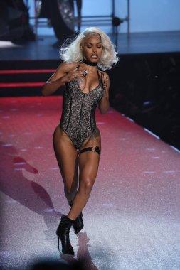 Teyana Taylor walks the runway at the Philipp Plein fashion show
